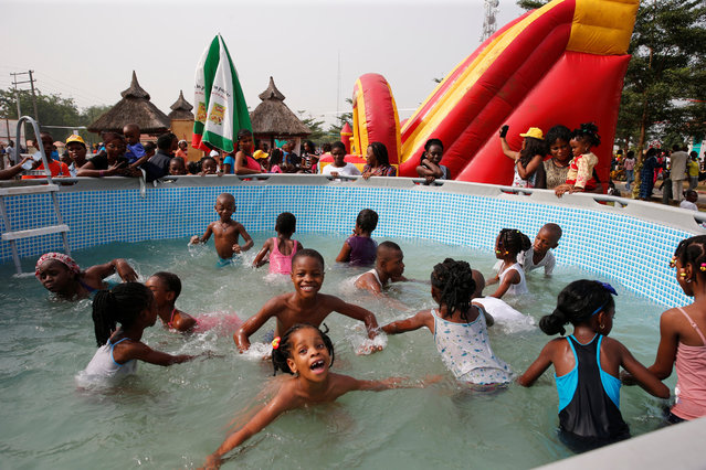 Children play in a pool at an amusement park during Boxing Day in Ikeja district, in Nigeria's commercial capital Lagos, December 26, 2016. (Photo by Aintunde Akinleye/Reuters)
