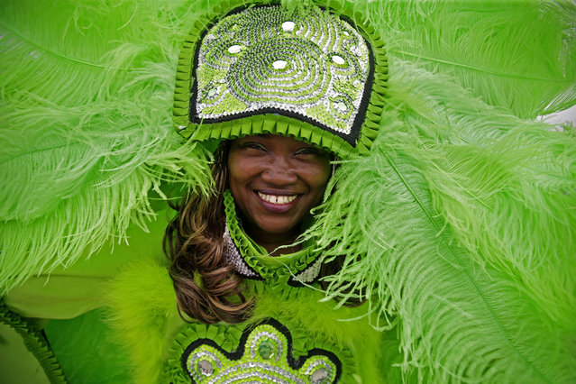 Lorenza Lawless, a member of the Black Mohawk Mardi Gras Indians, parades with the group at the Jazz and Heritage Festival in New Orleans, Friday, April 24, 2015. (Photo by Gerald Herbert/AP Photo)