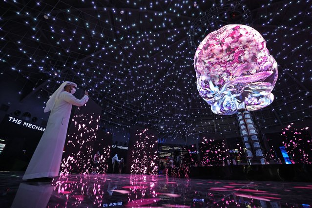 A visitor takes pictures inside the Russian Pavilion of Expo 2020, in Dubai on October 5, 2021. (Photo by Giuseppe Cacace/AFP Photo)