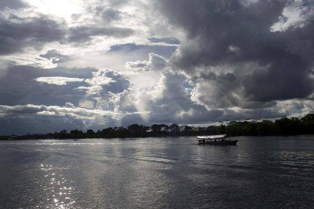 In this April 18, 2015 photo, a house boat floats on the River Nanay, near the Amazon Animal Orphanage in the Pilpintuwasi Peruvian rainforest, where more than three dozen animals rescued from circuses and animal traffickers, were given permanent homes Saturday, an action organized by the British charity, Animal Defenders International. (Photo by Rodrigo Abd/AP Photo)