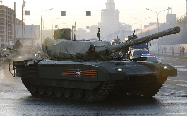 Russian servicemen drive a partially covered T-14 Armata tank along a street before a rehearsal for the Victory Day parade in Moscow, Russia, April 29, 2015. (Photo by Maxim Zmeyev/Reuters)