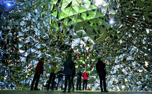 Visitors walk through the Swarowski Crystal World museum on its reopening day following renovation, in the western Austrian village of Wattens April 30, 2015. (Photo by Dominic Ebenbichler/Reuters)