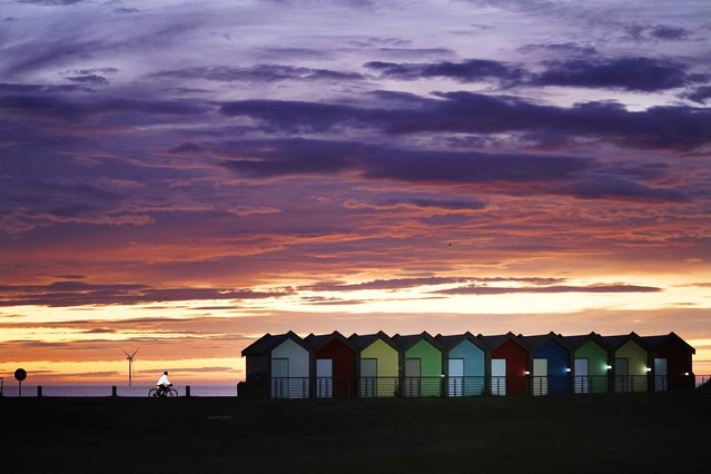 Dawn at Blyth beach huts in Northumberland, with the prospect of warm weather over the coming weekend on Friday, October 8, 2021. (Photo by Owen Humphreys/PA Images via Getty Images)