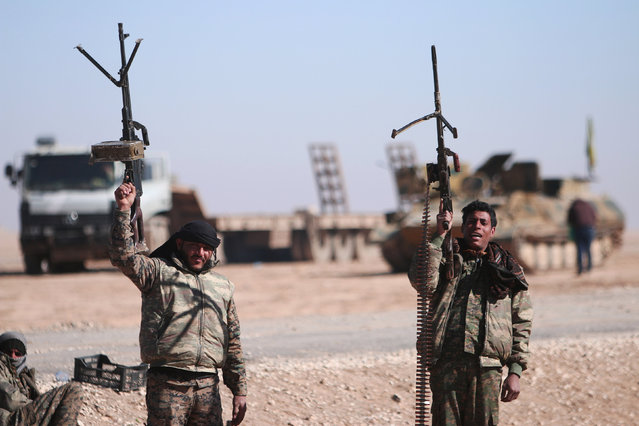 Syrian Democratic Forces (SDF) fighters hold up their weapons in the north of Raqqa city, Syria February 3, 2017. Picture taken February 3, 2017. (Photo by Rodi Said/Reuters)