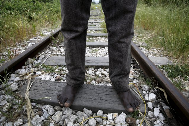 26-year-old Azam from South Sudan stands on rail tracks after failing to flee to Italy in the western Greek town of Patras April 28, 2015. (Photo by Yannis Behrakis/Reuters)