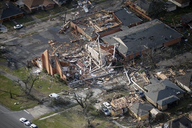 A destroyed church and homes are seen in this aerial photo after a tornado tore through the eastern neighborhood in New Orleans, Tuesday, February 7, 2017. (Photo by Gerald Herbert/AP Photo)