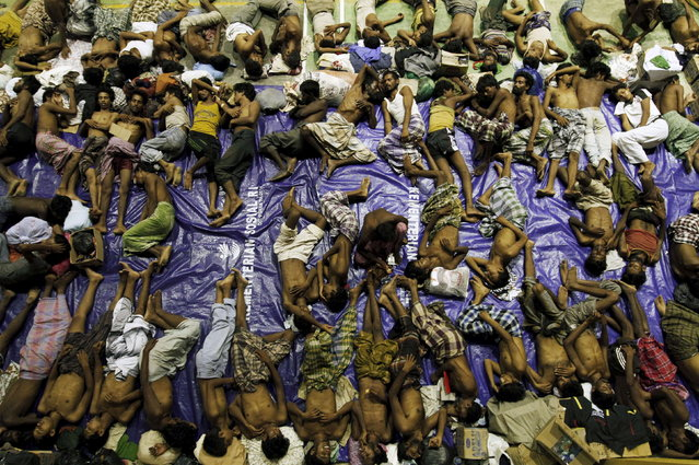 Migrants believed to be Rohingya rest inside a shelter after being rescued from boats at Lhoksukon in Indonesia's Aceh Province May 11, 2015. (Photo by Roni Bintang/Reuters)