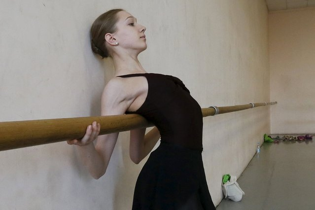 A student of the Krasnoyarsk choreographic college prepares before a dress rehearsal of a performance by graduates of the college at the State Theatre of Opera and Ballet in Russia's Siberian city of Krasnoyarsk, Russia, May 12, 2015. (Photo by Ilya Naymushin/Reuters)