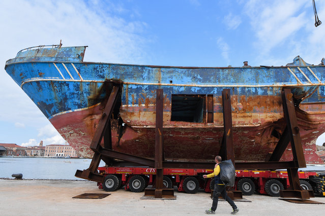 "The fishing vessel ""Barca Nostra"" (Our Ship) that sank on April 18, 2015 trapping hundreds of migrants in its hull, is being installed in Venice's former shipyards as part of the centerpiece of a new art project by Swiss-Icelandic artist Christoph Buechel, prior to the the 58th International Art Exhibition of the Venice Biennale, on May 7, 2019 in Venice. The 58th International Art Exhibition will open to the public  from May 11 to November 24, 2019. (Photo by Tiziana Fabi/AFP Photo)"