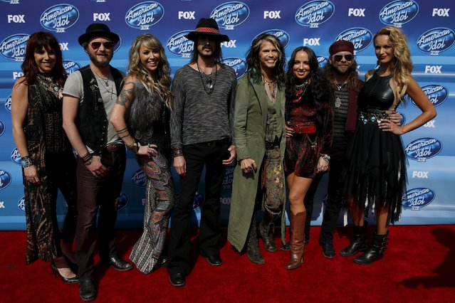 Singer Steven Tyler (center R) poses with the band Loving Mary as they arrive for the finale of Season 14 of American Idol in Los Angeles, California May 13, 2015. (Photo by Patrick T. Fallon/Reuters)