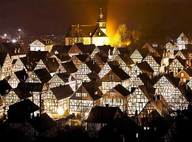 Timber-framed houses are seen in Freudenberg, central Germany, early Wednesday, March 6, 2019. (Photo by Michael Probst/AP Photo)