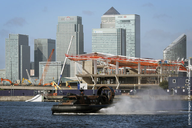 A hovercraft performs a demonstration in Albert dock outside the ExCel centre