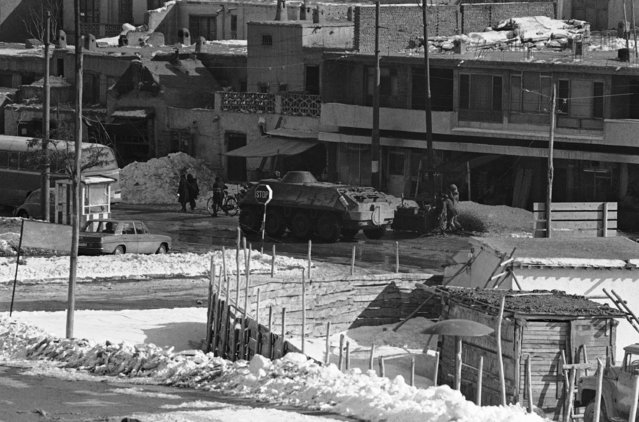 Soviet military vehicles rumbling through the streets of Kabul in January 1980. It is now over a month since Russia invaded Afghanistan. (Photo by AP Photo)