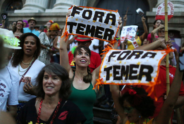 """Revellers take part in block party """"Fora Temer"""" (Out Temer), referring to Brazil's President Michel Temer, during pre-carnival festivities in Rio Janeiro, Brazil February 24, 2017. (Photo by Pilar Olivares/Reuters)"""