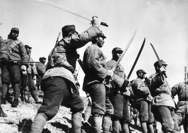 1933: In padded uniforms, Chinese 'Big Sword' troops wielding their weapons during the fighting to defend Jehol in the Sino-Chinese war