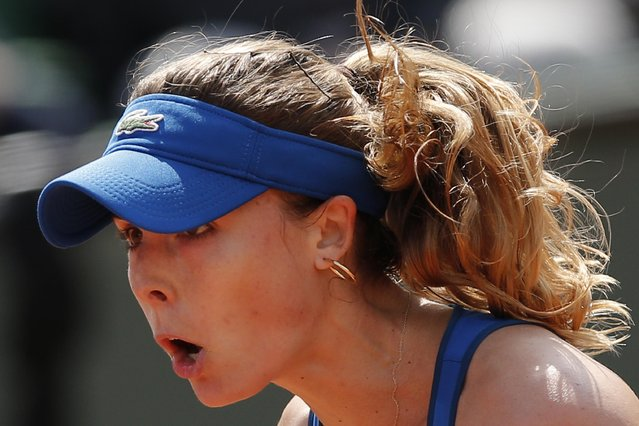 France's Alize Cornet reacts in the first round match of the French Open tennis tournament against Italy's Roberta Vinci at the Roland Garros stadium, in Paris, France, Monday, May 25, 2015. (Photo by Christophe Ena/AP Photo)