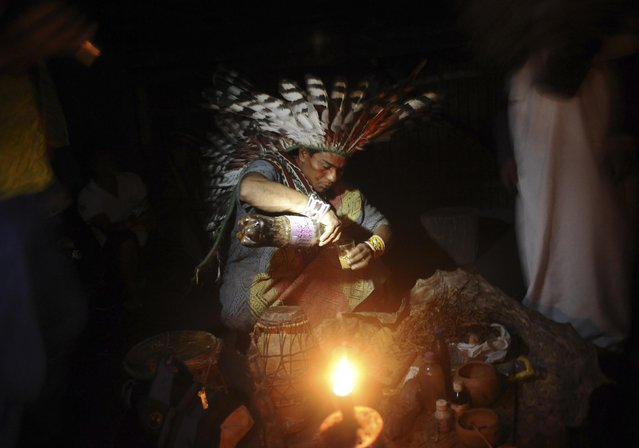 A Huni Kui Indian prepares a drink known as nixi pae or ayahuasca to use in a healing ritual in the village of Novo Segredo along the Envira river of Brazil's northwestern Acre state, March 8, 2014. (Photo by Lunae Parracho/Reuters)