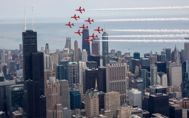The Royal Air Force Aerobatic Team, The Red Arrows perform a flypast with the skyline of Chicago, USA, 17 August 2019. The Red Arrows are displaying to hundreds of thousands of people at the 61st Chicago Air and Water Show. It forms part of the team's largest ever tour of North America, promoting the best of British and supporting a range of UK interests overseas. (Photo by Sgt Ashley Keates/EPA/EFE/Rex Features/Shutterstock/RAF/British Ministry of Defence)