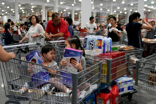 People visit the first Chinese location of the U.S. hypermarket chain Costco Wholesale Corp store in Shanghai, China on August 28, 2019. (Photo by Aly Song/Reuters)