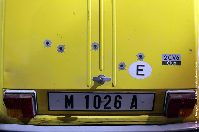Bullet hole stickers on the rear of a Citroen 2CV6 that was used in the 1981 James Bond film For Your Eyes Only and is currently being displayed at the Bond In Motion exhibition