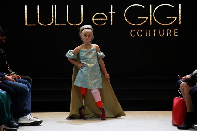 Model Daisy-May Demetre presents a creation by designer Eni Hegedus-Buiron for luxury children's wear label Lulu et Gigi during Paris Fashion Week in Paris, France, September 27, 2019. Nine-year-old Demetre, whose legs were amputated due to a birth defect, became the first double amputee to walk the runway in Paris Fashion Week, when she modeled for Lulu et Gigi inside the Eiffel Tower. (Photo by Gonzalo Fuentes/Reuters)