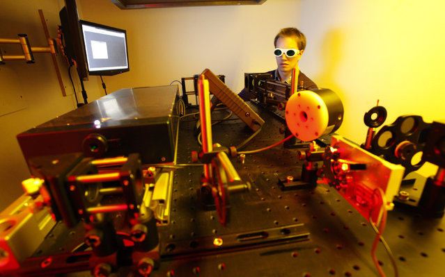 Dissertation student Jan Torgersen of Vienna University of Technology operates a newly developed 3D laser printer, in Vienna March 29, 2012. Torgersen and colleagues have set a new world speed record for creating 3D nano objects. (Photo by Herwig Prammer/Reuters)
