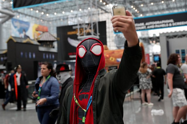 A person dressed as Spider-Man takes a selfie attending the 2019 New York Comic Con in New York City, New York, U.S., October 3, 2019. (Photo by Shannon Stapleton/Reuters)