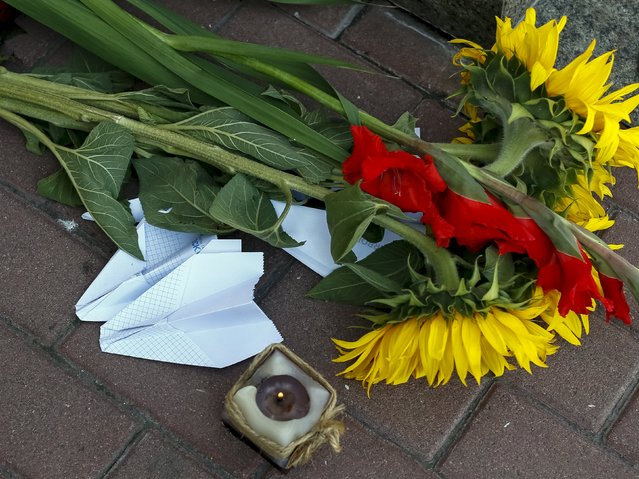 Flowers and paper airplanes are seen outside the Dutch embassy to commemorate the victims of the downing of Malaysia Airlines MH17 in eastern Ukraine a year ago, in Kiev, Ukraine July 17, 2015. (Photo by Gleb Garanich/Reuters)
