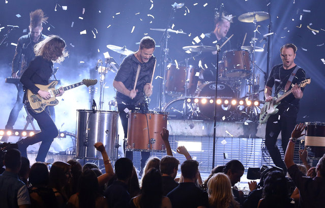 "Dan Reynolds, Ben McKee, Daniel Platzman and Wayne ""Wing"" Sermon of Imagine Dragons perform onstage during the 2014 Billboard Music Awards held at MGM Grand Garden Arena on May 18, 2014 in Las Vegas, Nevada. (Photo by Michael Tran/FilmMagic)"