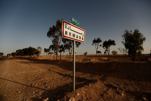 A sign is seen at the edge of Remada, Tunisia April 11, 2016. (Photo by Zohra Bensemra/Reuters)