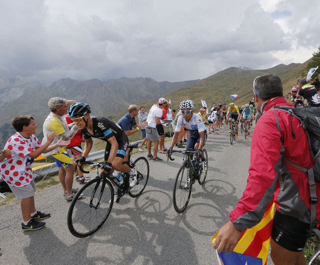 Australia's Richie Porte, Colombia's Nairo Quintana, wearing the best young rider's white jersey, Britain's Chris Froome, wearing the overall leader's yellow jersey, and Italy's Vincenzo Nibali, from front to rear, climb during the seventeenth stage of the Tour de France cycling race over 161 kilometers (100 miles) with start in Digne-les-Bains and finish in Pra Loup, France, Wednesday, July 22, 2015. (Photo by Christophe Ena/AP Photo)