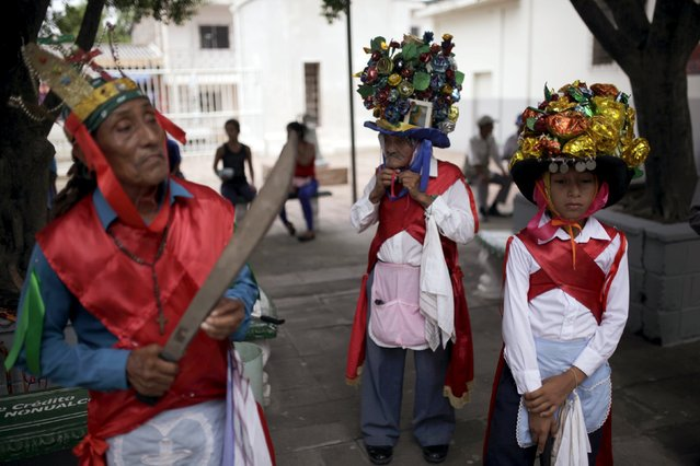 Participants of the traditional dance of Los Historiantes perform during the festivity held in honour of Saint James, in Santiago Nonualco July 22, 2015. (Photo by Jose Cabezas/Reuters)