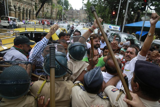 India's Bharatiya Janata Party (BJP) activists supporting death penalty of 1993 Mumbai blasts accused Yakub Abdul Razak Memon, are stopped by police during a protest in Mumbai, India, Wednesday, July 29, 2015. Memon, an accountant, convicted of providing financial and logistical support in the series of bombings that shook India's business and entertainment hub in 1993 is scheduled to be hanged Thursday, July 30, 2015. (Photo by Rafiq Maqbool/AP Photo)