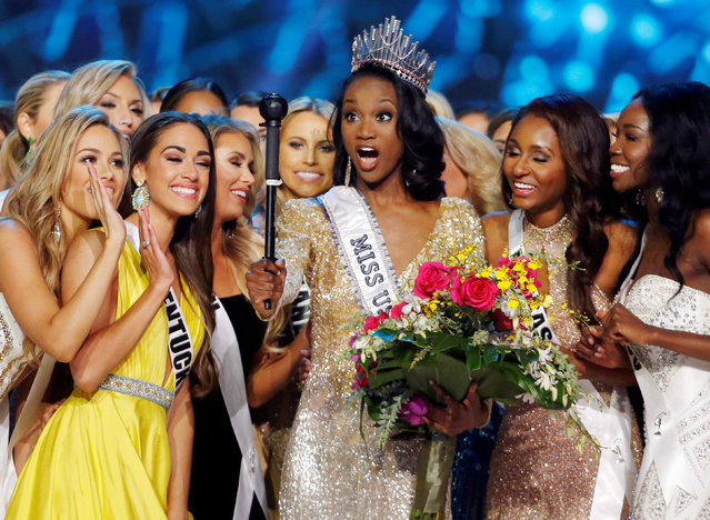 Deshauna Barber (C) of the District of Columbia poses with other contestants after being crowned Miss USA 2016 during the 2016 Miss USA pageant at the T-Mobile Arena in Las Vegas, Nevada, U.S., June 5, 2016. (Photo by Steve Marcus/Reuters)