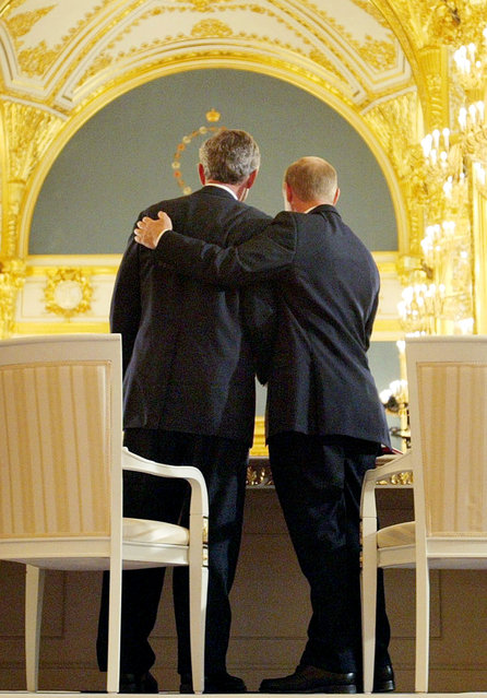 Russian President Vladimir Putin, right, puts his arm around President Bush after the two leaders signed  an arms treaty at the Kremlin in Moscow, Russia, Friday, May 24, 2002. The two leaders signed a treaty cutting the number of strategic nuclear warheads over 10 years to one-third their current level, a declaration on a new strategic relationship and a statement on cooperation in the field of energy. (Photo by Doug Mills/AP Photo)