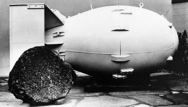 """This October 15, 1965, file photo shows a """"Fat Man"""" nuclear bomb of the type tested at Trinity Site, N.M, and dropped on Nagasaki, Japan in 1945, on view for the public at the Los Alamos Scientific Laboratory Museum. Thursday, July 16, 2015 marks the 70th anniversary of the Trinity Test in southern N.M.July marks the 71st anniversary of the Trinity Test in southern New Mexico. The milestone comes amid renewed interest in the Manhattan Project thanks to new books, online video testimonies and recently canceled TV drama series """"Manhattan"""". (Photo by AP Photo)"""
