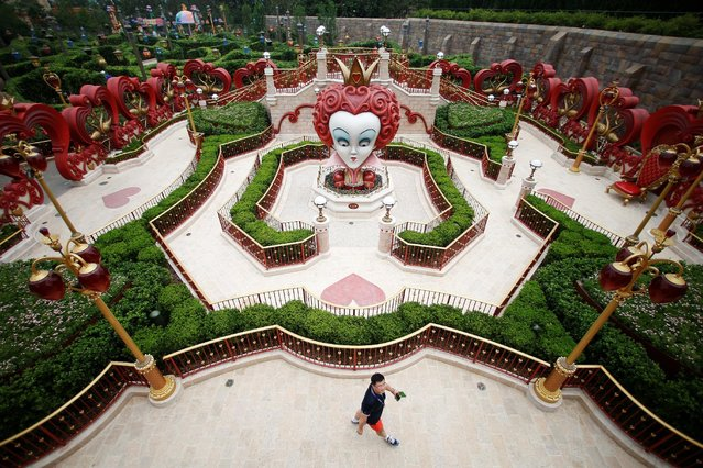 A man visits Shanghai Disney Resort during a three-day Grand Opening event in Shanghai, China, June 15, 2016. (Photo by Aly Song/Reuters)