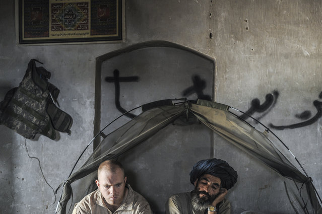 Van Agtmael says that the main difference between the two wars was that soldiers in Iraq stayed on mega-bases of 10-40,000 men, while in Afghanistan, soldiers were usually stationed at outposts of 10-150 men. (Photo and caption by Van Agtmael/Harrison Jacobs/Magnum Photos)