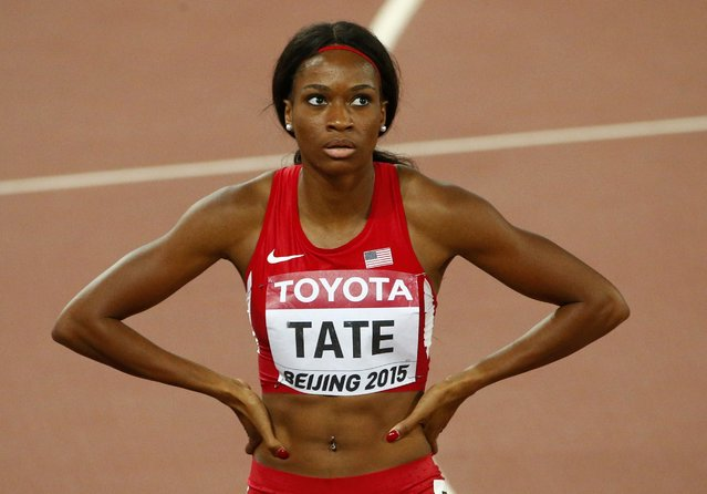 Cassandra Tate of U.S. looks at the scoreboard after winning the women's 400 metres hurdles semi-final during the 15th IAAF World Championships at the National Stadium in Beijing, China August 24, 2015. (Photo by David Gray/Reuters)