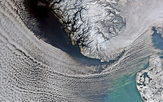 Clouds sweep across the North Sea in this image from Envistat. Denmark is on the lower right corner and Norway is in the upper center. (Photo by The European Space Agency)
