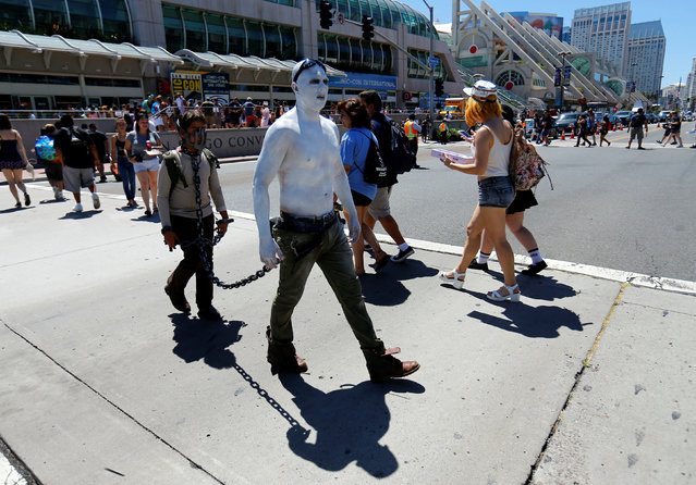 Two men in costume make their way across the street info of the convention center holding the pop culture event Comic-Con International in San Diego, California, United States, July 22, 2016. (Photo by Mike Blake/Reuters)