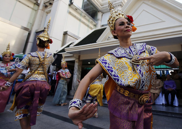 Thai classical dancers perform for Phra Phrom, the Thai interpretation of the Hindu god Brahma, at the Erawan Shrine in Bangkok, Thailand, Friday, September 4, 2015. (Photo by Sakchai Lalit/AP Photo)
