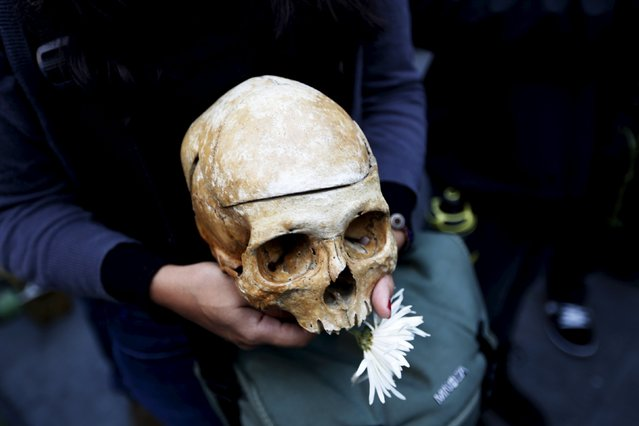 A protester holds a skull during a protest against what protesters say is the death of Guatemalan democracy in Guatemala City, September 5, 2015. Guatemala on Sunday will hold a presidential election. (Photo by Jorge Dan Lopez/Reuters)