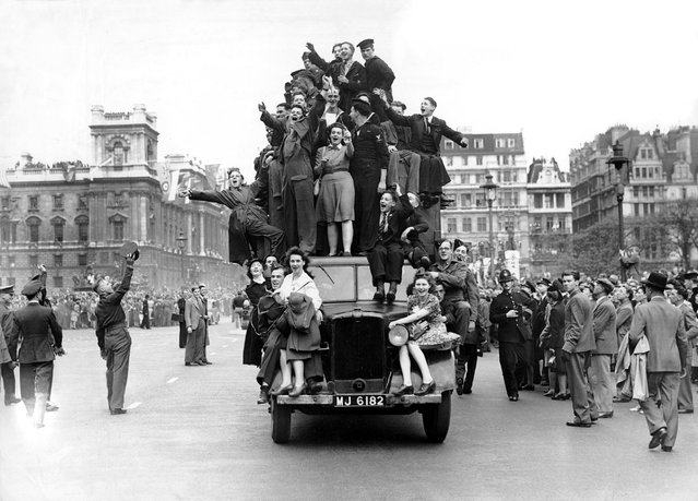 Londoners celebrate Victory in Europe Day (VE Day) to mark the end of European conflict in World War II in London, England on 8th May 1945. (Photo by ANL/Daily Mail/Rex Features/Shutterstock)
