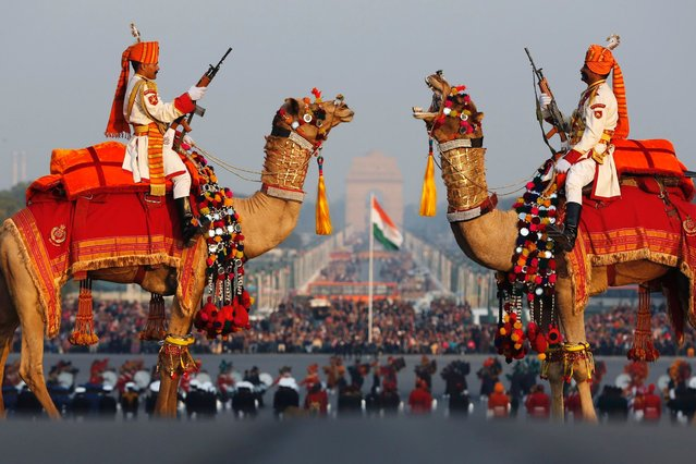 "India's Border Security Force soldiers ride their camels as they rehearse for the ""Beating the Retreat"" ceremony in New Delhi January 27, 2013. (Photo by Adnan Abidi/Reuters)"