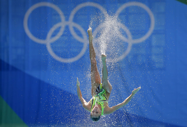 A team member of Ukraine's synchronized swimming team is thrown into the air during the synchronized swimming team technical routine final in the Maria Lenk Aquatic Center at the 2016 Summer Olympics in Rio de Janeiro, Brazil, Thursday, August 18, 2016. (Photo by Wong Maye-E/AP Photo)