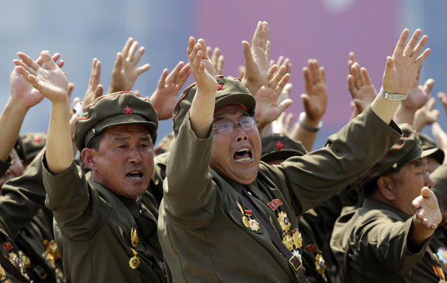 Korean War veterans react as they shout slogans to North Korean leader Kim Jong-un during a parade to mark the 60th anniversary of the signing of a truce in the 1950-1953 Korean War at Kim Il-sung Square, in Pyongyang, July 27, 2013. (Photo by Jason Lee/Reuters)