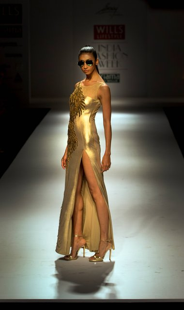 An Indian model displays a creation by designer Ankita during Wills Lifestyle India Fashion Week, in New Delhi, India, Friday, October 10, 2014. (Photo by Manish Swarup/AP Photo)