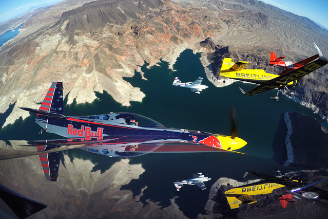 Pete McLeod of Canada flies in formation with Nigel Lamb of Great Britain, Martin Sonka of the Czech Republic and Kirby Chambliss of the United States during a Recon flight prior to the seventh stage of the Red Bull Air Race World Championship over the Hoover Dam on October 09, 2014 on the border between the U.S. states of Arizona and Nevada. (Photo by Joerg Mitter/Red Bull via Getty Images)