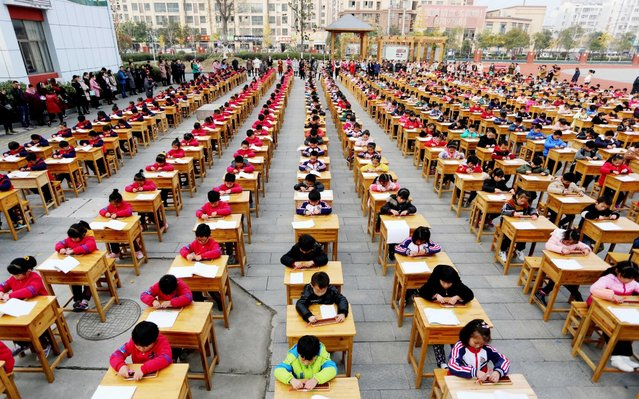 More than 500 students attend a mental abacus contest at a primary school in Donghai County, east China's Jiangsu Province on November 21, 2017. (Photo by Zhang Kaihu/Photoshot/Avalon)
